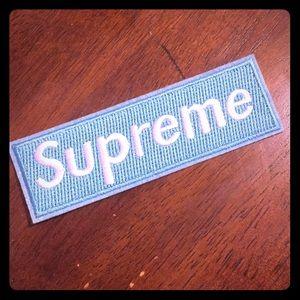 Supreme clothes patch
